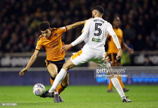 Wolverhampton Wanderers' Morgan GibbsWhite is tackled by Hull City's Michael Hector during the Sky Bet Championship match at Molineux Wolverhampton