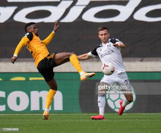 Wolverhampton Wanderers' Nelson Semedo and Fulhams Joe Bryan vie for possession during the Premier League match between Wolverhampton Wanderers and...