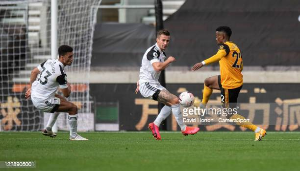 Wolverhampton Wanderers' Nelson Semedo battles with Fulhams Antonee Robinson and Joe Bryan during the Premier League match between Wolverhampton...