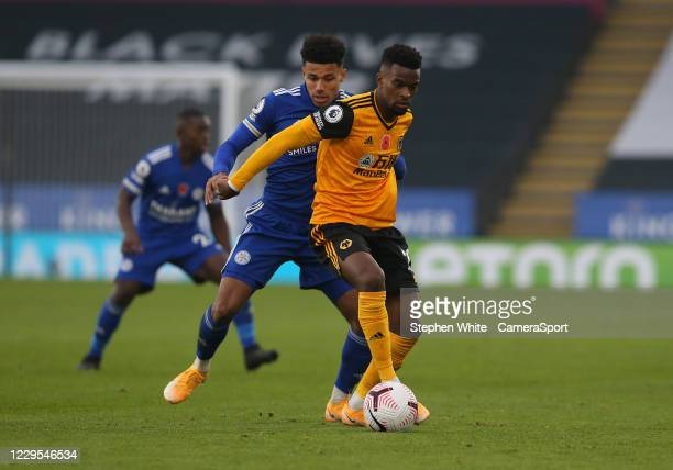 Wolverhampton Wanderers' Nelson Semedo shields the ball from Leicester City's James Justin during the Premier League match between Leicester City and...