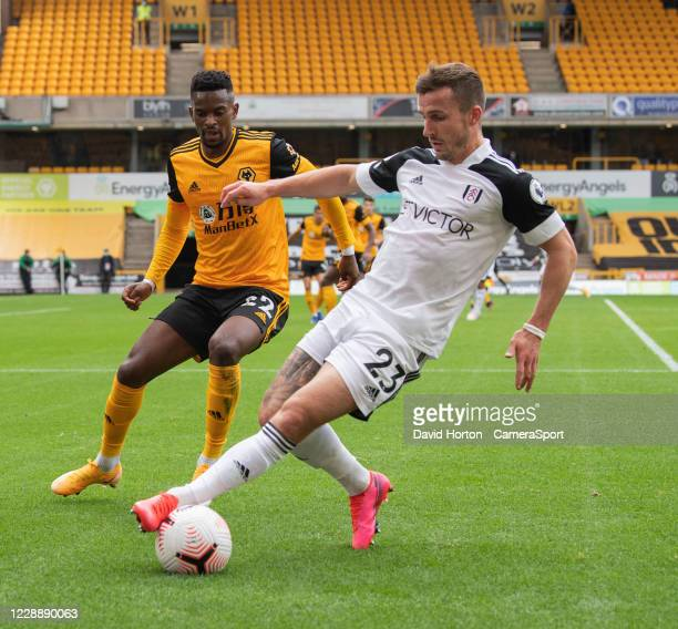 Wolverhampton Wanderers' Nelson Semedo vies for possession with Fulhams Joe Bryan during the Premier League match between Wolverhampton Wanderers and...
