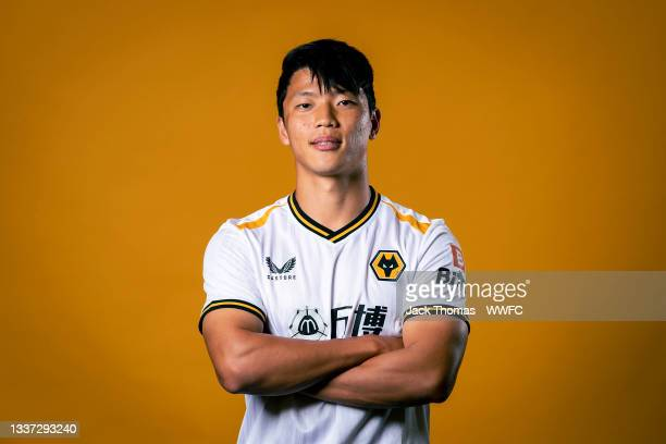 Wolverhampton Wanderers New Signing Hee-chan Hwang poses for a portrait at Sir Jack Hayward Training Ground on August 29, 2021 in Wolverhampton,...