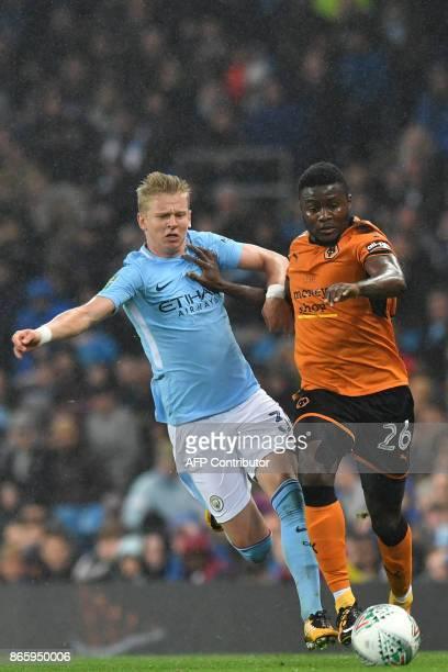Wolverhampton Wanderers' Nigeran striker Bright Enobokhare vies with Manchester City's Ukrainian midfielder Oleksandr Zinchenko during the English...