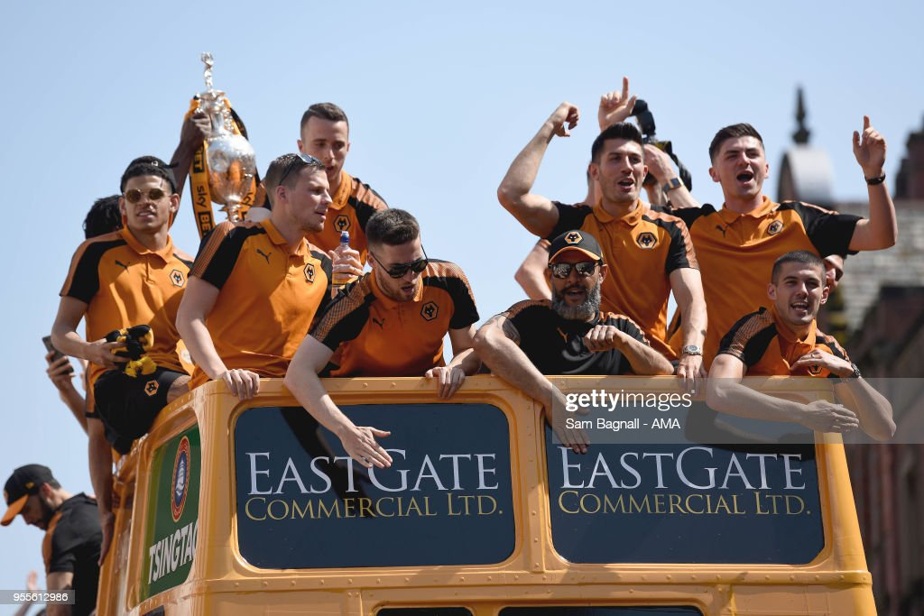 Wolverhampton Wanderers on an open topped bus during their celebrations of winning the Sky Bet Championship on a winners parade around the city of Wolverhampton on May 7, 2018 in Wolverhampton, England.
