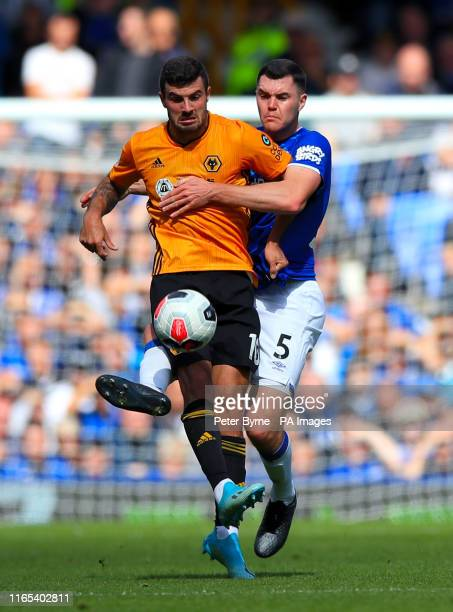 Wolverhampton Wanderers' Patrick Cutrone and Everton's Michael Keane battle for the ball during the Premier League match at Goodison Park Liverpool