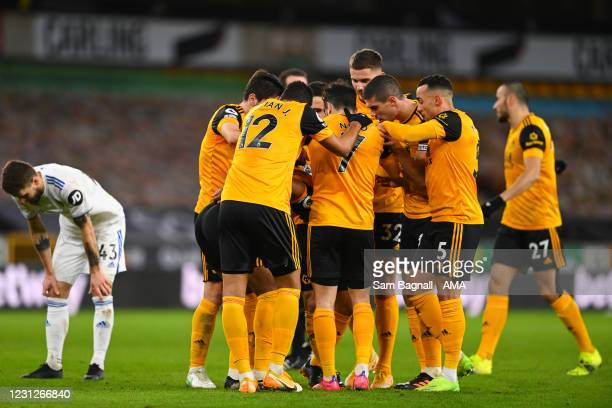 Wolverhampton Wanderers players celebrate after scoring a goal to make it 1-0 after an own goal by goalkeeper Illan Meslier of Leeds United during...
