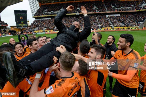 Wolverhampton Wanderers players celebrate promotion to the Premier League with Nuno Espirito Santo manager / head coach of Wolverhampton Wanderers...