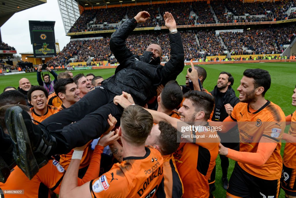 Wolverhampton Wanderers players celebrate promotion to the Premiership with Nuno Espirito Santo manager / head coach of Wolverhampton Wanderers during the Sky Bet Championship match between Wolverhampton Wanderers and Birmingham City at Molineux on April 15, 2018 in Wolverhampton, England.