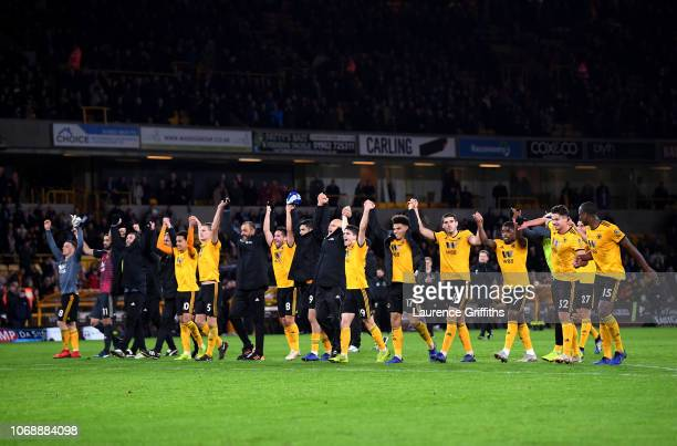 Wolverhampton Wanderers players celebrate their team's victory after the Premier League match between Wolverhampton Wanderers and Chelsea FC at...