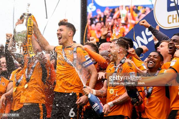 Wolverhampton Wanderers players celebrate winning the EFL Sky Bet Championship during the Sky Bet Championship match between Wolverhampton Wanderers...
