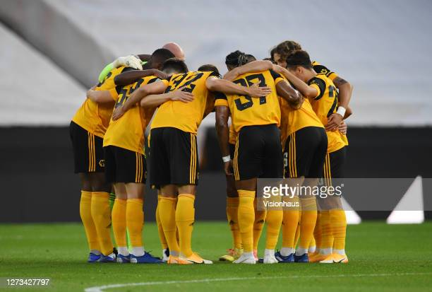 Wolverhampton Wanderers players form a prematch huddle prior to the Carabao Cup second round match between Wolverhampton Wanderers and Stoke City at...