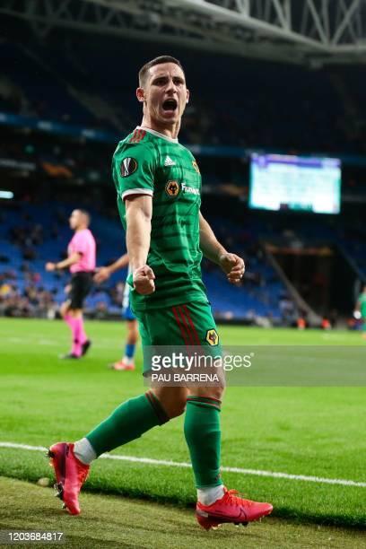 Wolverhampton Wanderers' Portuguese forward Daniel Podence celebrates after Wolverhampton Wanderers' Irish defender Matt Doherty scored during the...