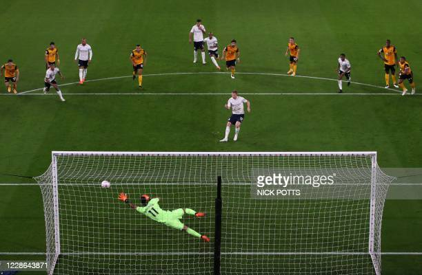 Wolverhampton Wanderers' Portuguese goalkeeper Rui Patricio dives in vain as Manchester City's Belgian midfielder Kevin De Bruyne shoots from the...