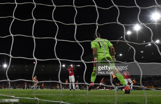 Wolverhampton Wanderers' Portuguese goalkeeper Rui Patricio reacts after saving a penalty shot from Manchester United's French midfielder Paul Pogba...