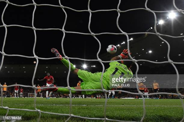 Wolverhampton Wanderers' Portuguese goalkeeper Rui Patricio saves a penalty shot from Manchester United's French midfielder Paul Pogba during the...