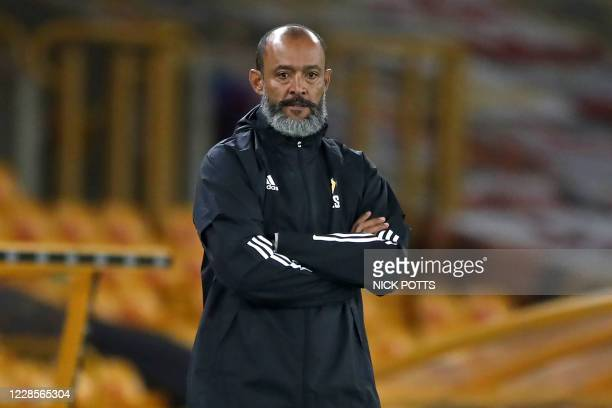 Wolverhampton Wanderers' Portuguese head coach Nuno Espirito Santo watches from the touchline during the English League Cup second round football...
