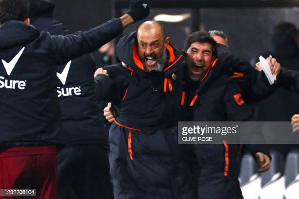 Wolverhampton Wanderers' Portuguese head coach Nuno Espirito Santo celebrates with his assistants after a late winning goal from Wolverhampton...