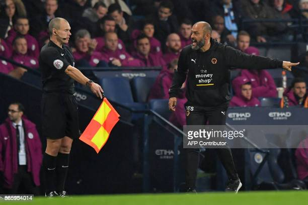 Wolverhampton Wanderers' Portuguese head coach Nuno Espirito Santo gestures to the assistant referee on the touchline during the English League Cup...