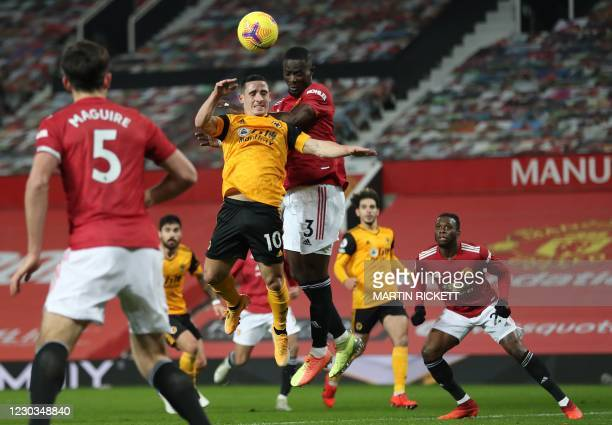 Wolverhampton Wanderers' Portuguese midfielder Daniel Podence and Manchester United's Ivorian defender Eric Bailly compete during the English Premier...