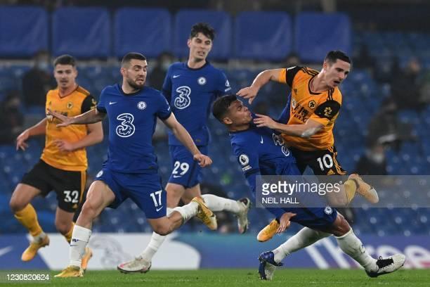 Wolverhampton Wanderers' Portuguese midfielder Daniel Podence and Chelsea's Brazilian defender Thiago Silva collide during the English Premier League...
