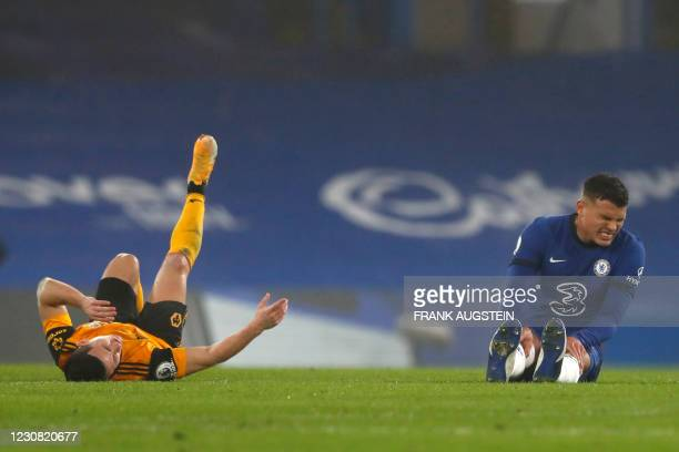 Wolverhampton Wanderers' Portuguese midfielder Daniel Podence and Chelsea's Brazilian defender Thiago Silva lie on the pitch during the English...
