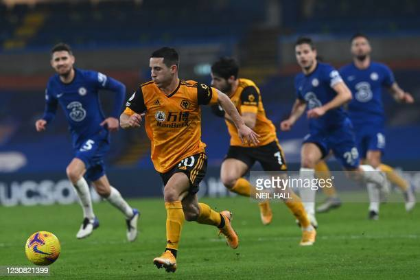 Wolverhampton Wanderers' Portuguese midfielder Daniel Podence controls the ball during the English Premier League football match between Chelsea and...