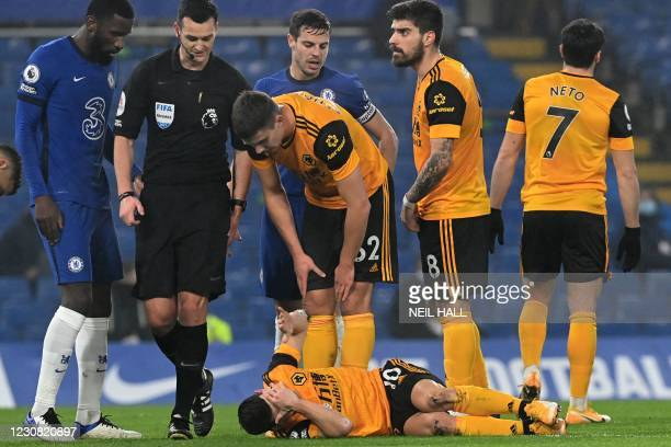 Wolverhampton Wanderers' Portuguese midfielder Daniel Podence lies injured during the English Premier League football match between Chelsea and...