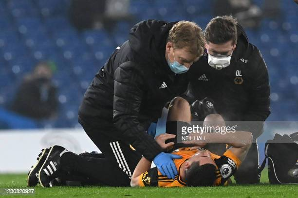 Wolverhampton Wanderers' Portuguese midfielder Daniel Podence receives medical attention during the English Premier League football match between...