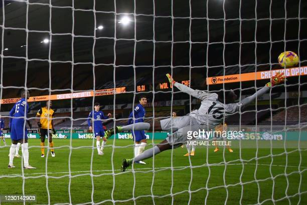 Wolverhampton Wanderers' Portuguese midfielder Daniel Podence scores his team's first goal during the English Premier League football match between...