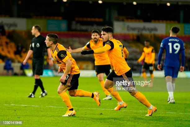 Wolverhampton Wanderers' Portuguese midfielder Daniel Podence celebrates scoring his team's first goal during the English Premier League football...