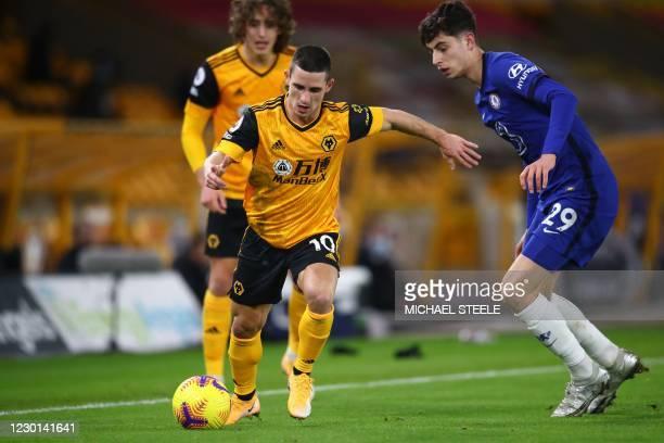Wolverhampton Wanderers' Portuguese midfielder Daniel Podence vies with Chelsea's German midfielder Kai Havertz during the English Premier League...