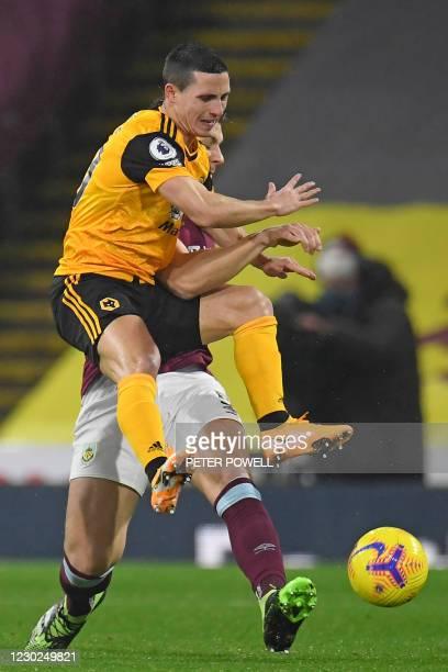 Wolverhampton Wanderers' Portuguese midfielder Daniel Podence vies with Burnley's English defender James Tarkowski during the English Premier League...