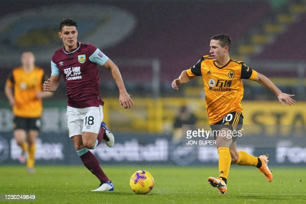 Wolverhampton Wanderers' Portuguese midfielder Daniel Podence vies with Burnley's English midfielder Ashley Westwood during the English Premier...