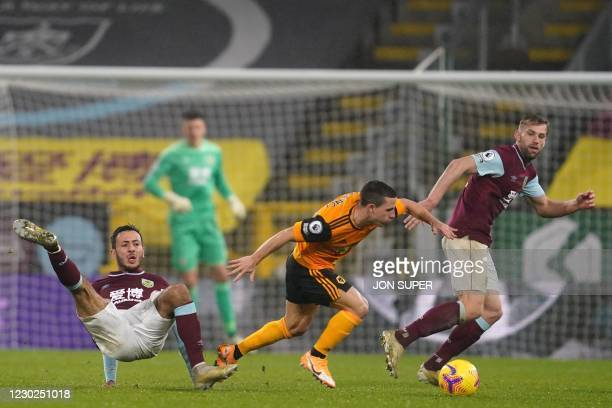 Wolverhampton Wanderers' Portuguese midfielder Daniel Podence vies with Burnley's English midfielder Dwight McNeil and Burnley's English defender...