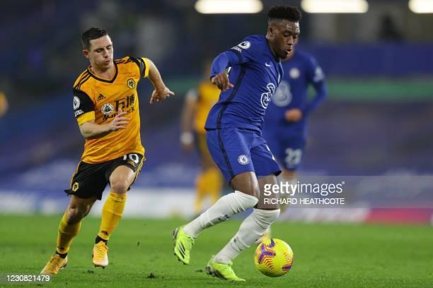 Wolverhampton Wanderers' Portuguese midfielder Daniel Podence vies with Chelsea's English midfielder Callum Hudson-Odoi during the English Premier...