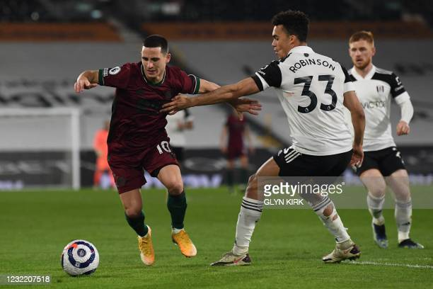 Wolverhampton Wanderers' Portuguese midfielder Daniel Podence vies with Fulham's English-born US defender Antonee Robinson during the English Premier...