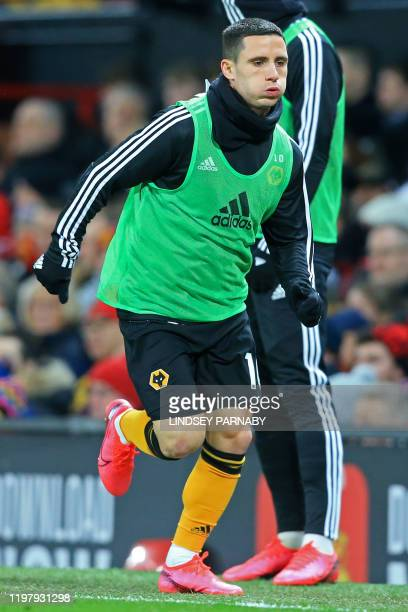 Wolverhampton Wanderers' Portuguese midfielder Daniel Podence warms up on the touchline during the English Premier League football match between...
