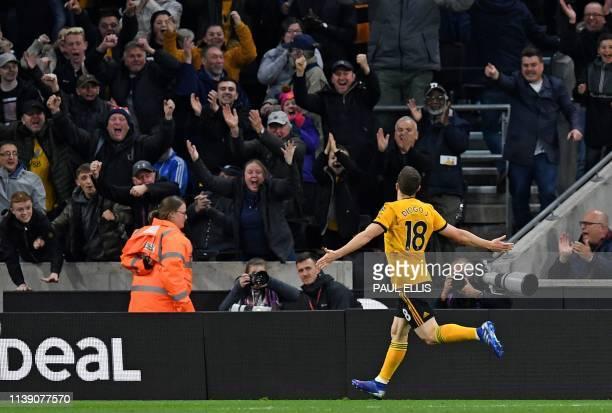 Wolverhampton Wanderers' Portuguese midfielder Diogo Jota celebrates scoring his team's third goal during the English Premier League football match...