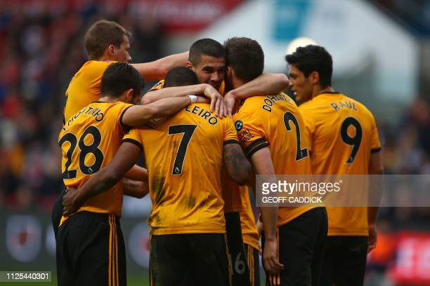 Wolverhampton Wanderers' Portuguese midfielder Ivan Cavaleiro celebrates with teammates after scoring the opening goal of the English FA Cup fifth...