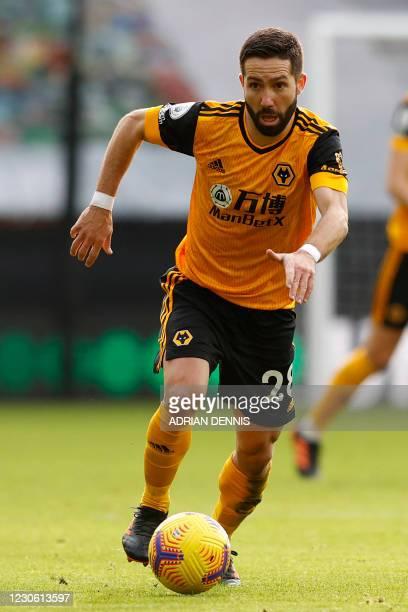 Wolverhampton Wanderers' Portuguese midfielder Joao Moutinho controls the ball during the English Premier League football match between Wolverhampton...