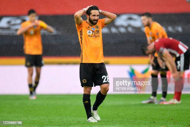 Wolverhampton Wanderers' Portuguese midfielder Joao Moutinho reacts at the end of the English Premier League football match between Sheffield United...