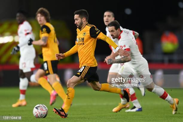 Wolverhampton Wanderers' Portuguese midfielder Joao Moutinho runs with the ball during the English FA Cup fifth round football match between...
