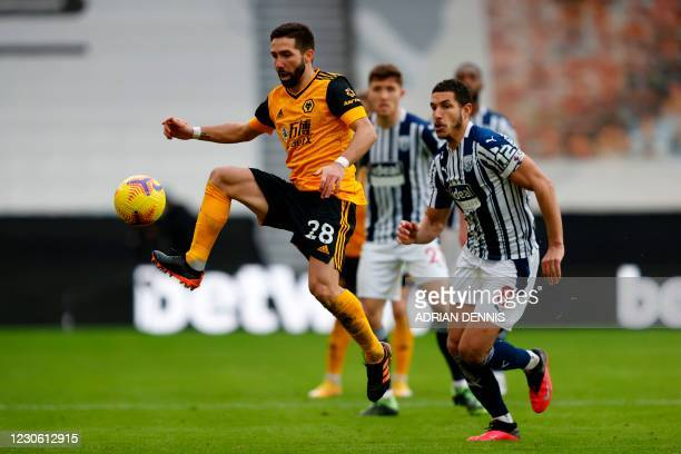 Wolverhampton Wanderers' Portuguese midfielder Joao Moutinho vies with West Bromwich Albion's English midfielder Jake Livermore during the English...