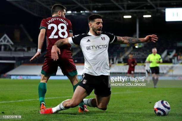 Wolverhampton Wanderers' Portuguese midfielder Joao Moutinho vies with Fulham's Serbian striker Aleksandar Mitrovic during the English Premier League...