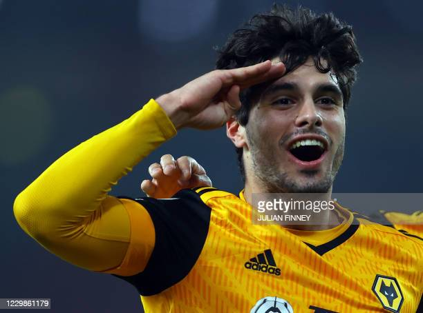 Wolverhampton Wanderers' Portuguese midfielder Pedro Neto celebrates scoring the opening goal during the English Premier League football match...