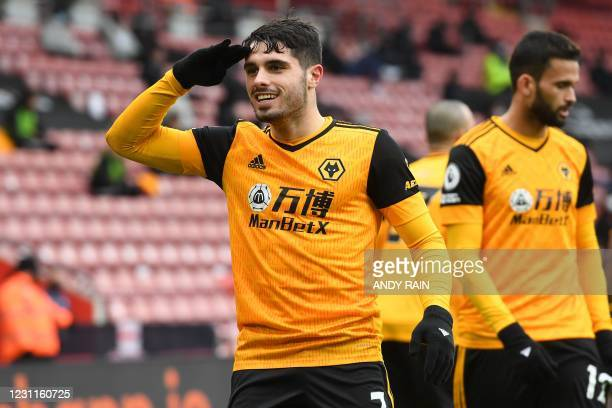 Wolverhampton Wanderers' Portuguese midfielder Pedro Neto celebrates after scoring their second goal during the English Premier League football match...