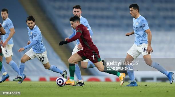 Wolverhampton Wanderers' Portuguese midfielder Pedro Neto runs with the ball during the English Premier League football match between Manchester City...