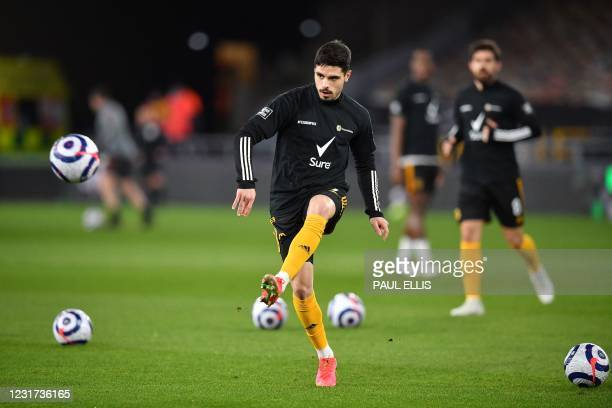 Wolverhampton Wanderers' Portuguese midfielder Pedro Neto warms up ahead of the English Premier League football match between Wolverhampton Wanderers...