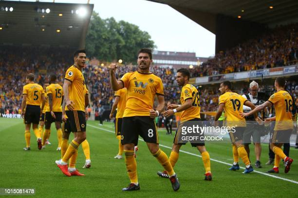 Wolverhampton Wanderers' Portuguese midfielder Ruben Neves celebrates scoring their first goal to equalise 11 during the English Premier League...