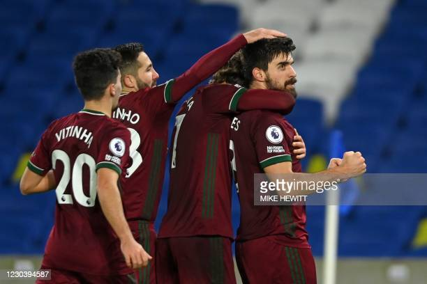 Wolverhampton Wanderers' Portuguese midfielder Ruben Neves celebrates scoring his team's third goal from the penalty spot during the English Premier...